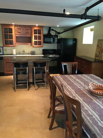 Open Living, Dining, Kitchen space. Gas range, mini dishwasher.