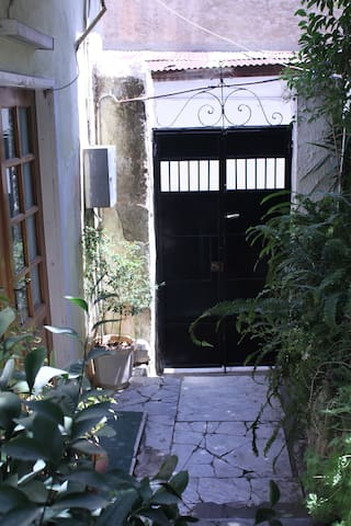 The outside black door and the brown house door