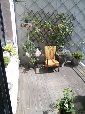 The terrace gets the sun all day long, peaceful and garden-facing.