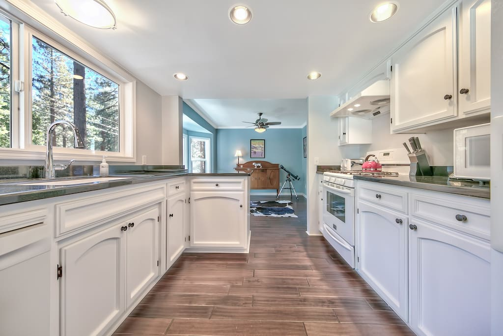 Whip up a bake of memories in this bright, open kitchen between the sun room and dining area