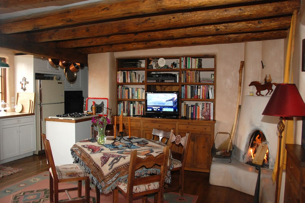 Den with dining, fireplace and kitchen
