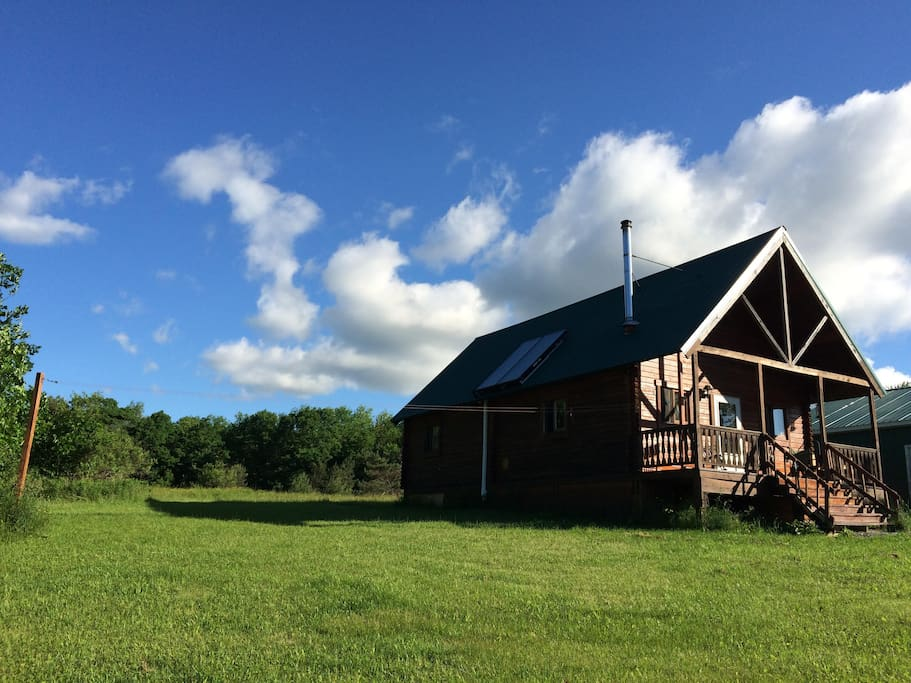 Year-round cabin sits on hilltop with great views.