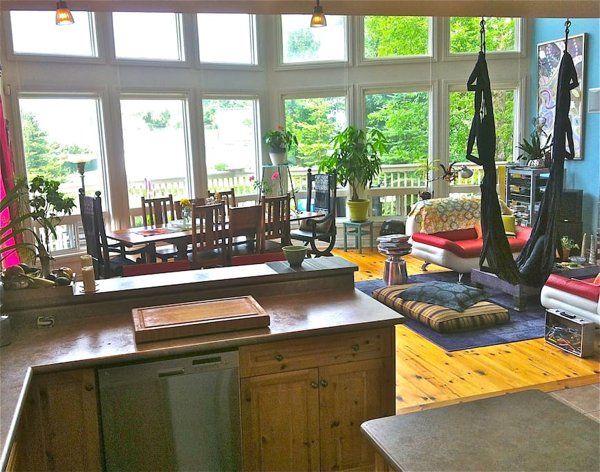 Making meals in the kitchen - sweet view into open living space & to the GREAT outdoors. YAY!