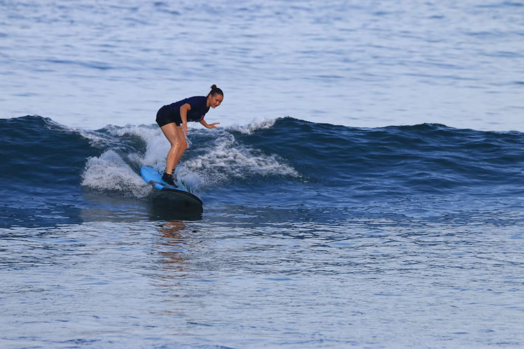 Learn to surf in front of hotel.