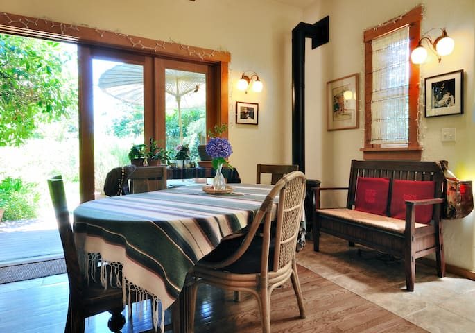 The shared kitchen and dining area are one large room with french doors to the garden.