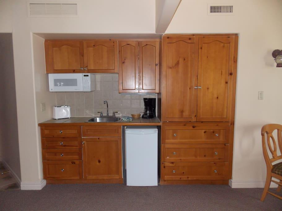 Mini Kitchen ... Bar Fridge ... TV is behind the doors aboves the three dresser drawer