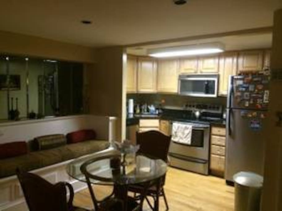 Kitchen with stainless steel appliances and all the necessary cooking supplies