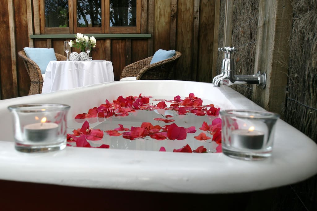 Romantic & relaxing private claw foot bath perched on the deck overlooking the river.