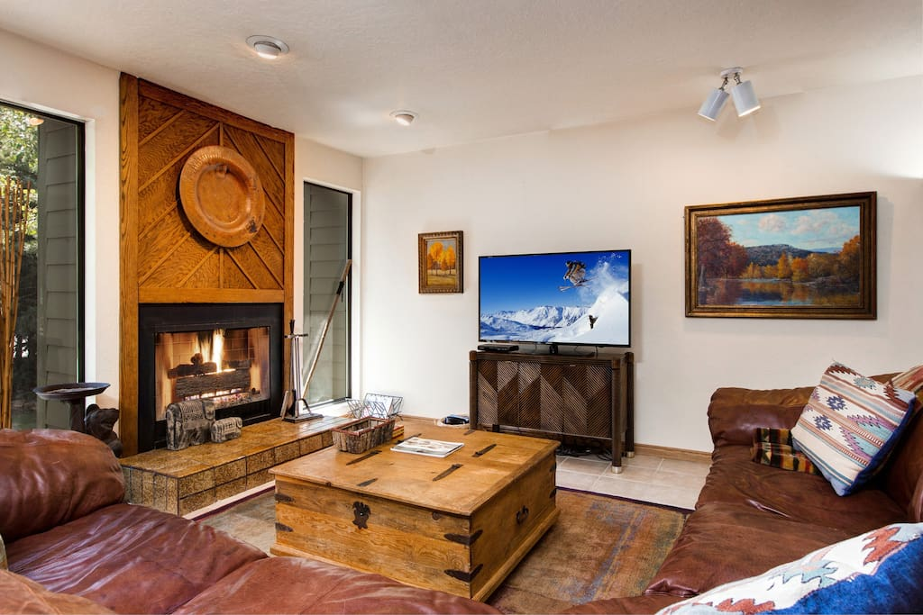 Find cozy couches gathered around a crackling fire in the main living room.