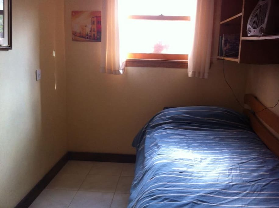 Small adjoining room (part of the same unit). Roll out bed