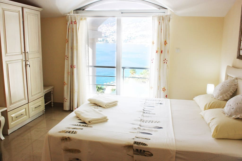 Two double bedrooms on the first floor with balcony and stunning view across Kalkan bay. One kingsize bed and two separate beds respectively (that can be combined into a kingsize bed)