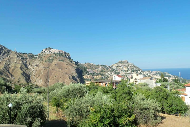 Taormina among almond and olive trees
