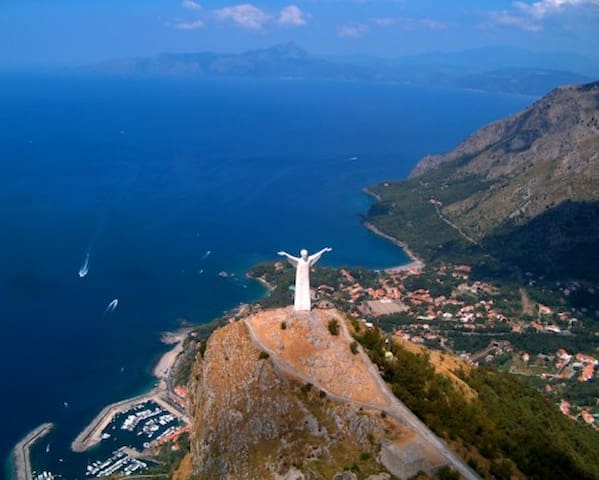 The statue of Jesus Christ on the top of the mounting in Maratea