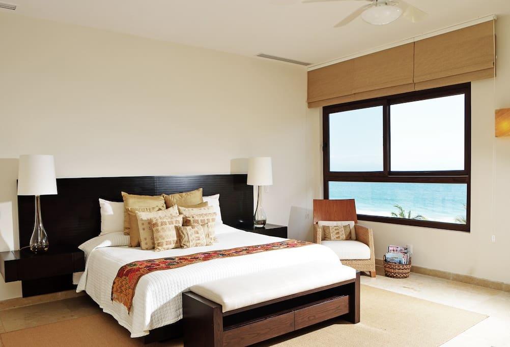 Amazing master bedroom with ocean views