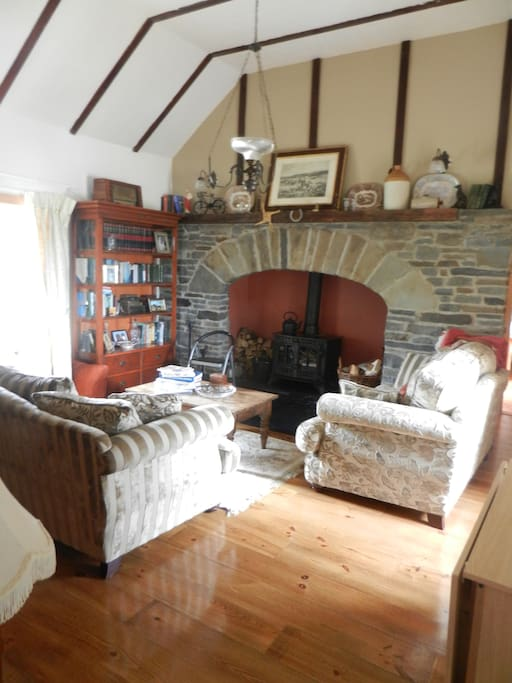 Homely living room with solid fuel stove.
