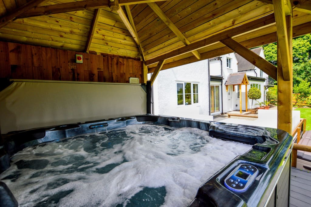 Hot tub with LED lighting, jets and waterfall