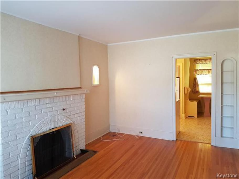 Living room with a fireplace. Furniture & TV not seen in picture.