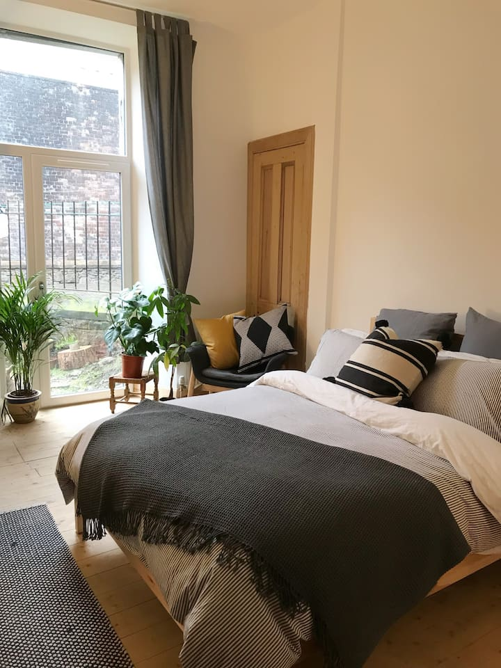 Newly renovated bright, spacious and cosy room with access to the garden and lots of greenery inside too