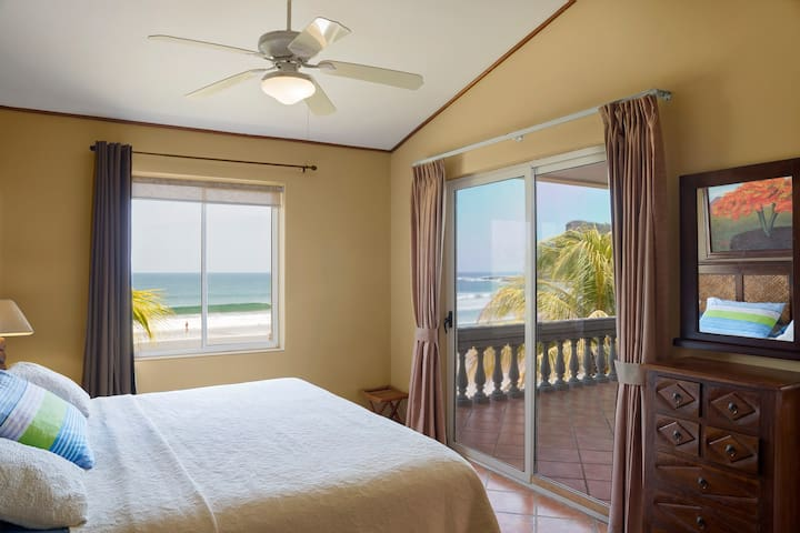Master bedroom with king size bed and view of the ocean