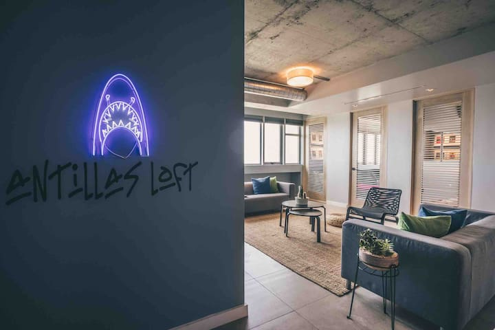 Living space with our signature shark neon art. Perfect for that social media check-in!