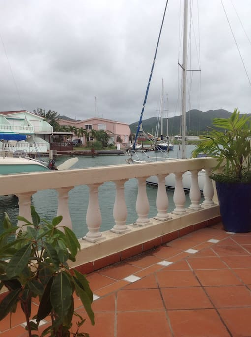 The balcony off the living room over looks the water.