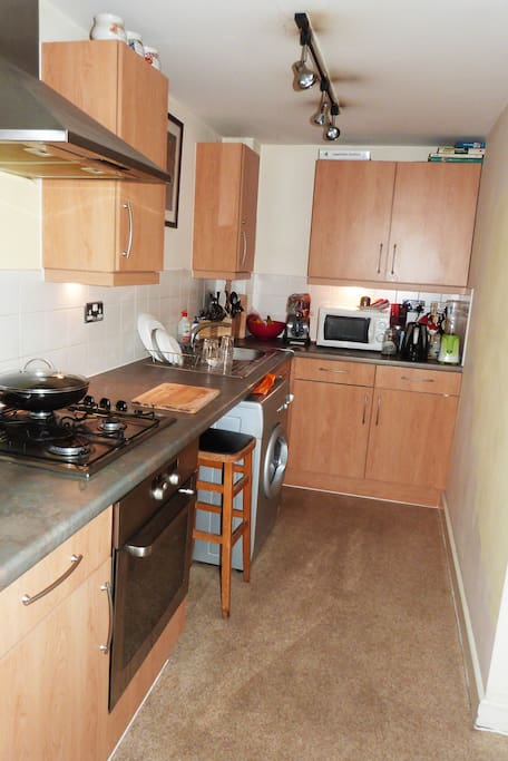 This kitchen has a microwave, oven, hobs, washing machine/dryer, fridge/freezer and every kind of cooking equipment you would need. It also has an extractor fan.
