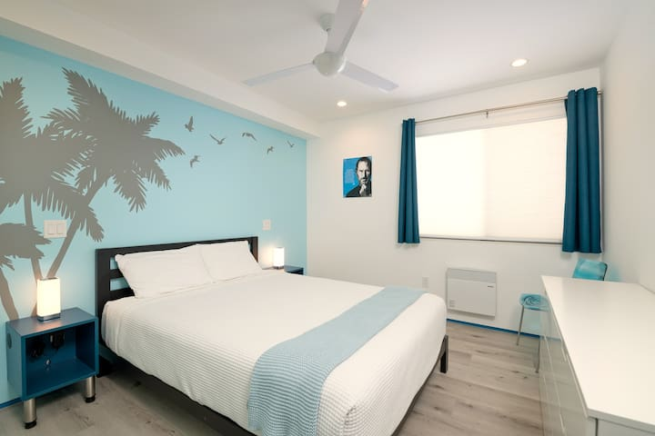 The 2nd bedroom is a more playful in style and features a comfortable Queen sized bed. Lights and ceiling fan can be controlled from either side of the bed. Like in the master bedroom, the night stands have built-in USB ports to charge your devices.