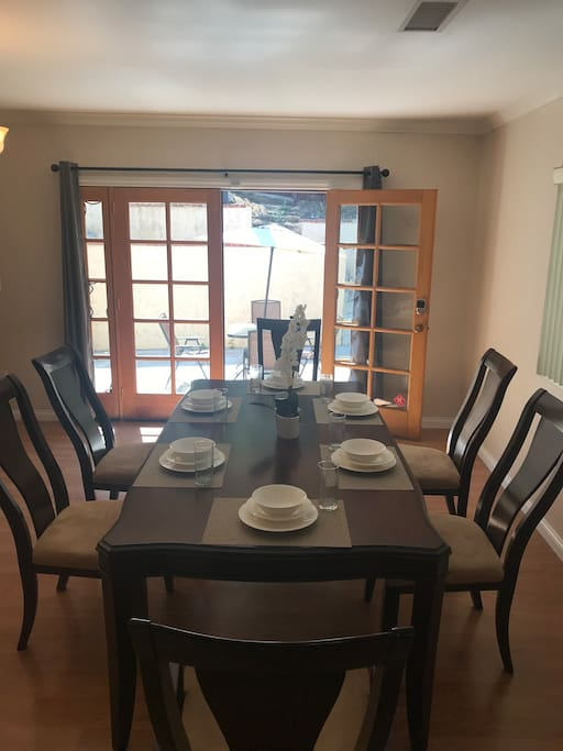 Large dining table sits for 6 and it can be extended to sit 8