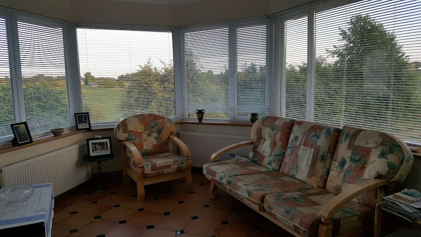 South-facing sunroom with views across to the village