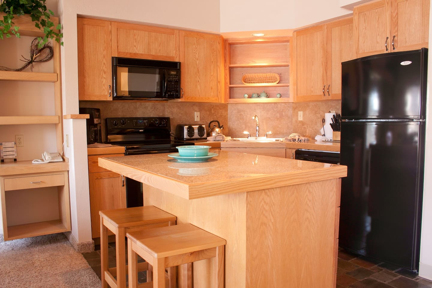 Fully stocked kitchen with all appliances, cookware, utensils and coffee maker.