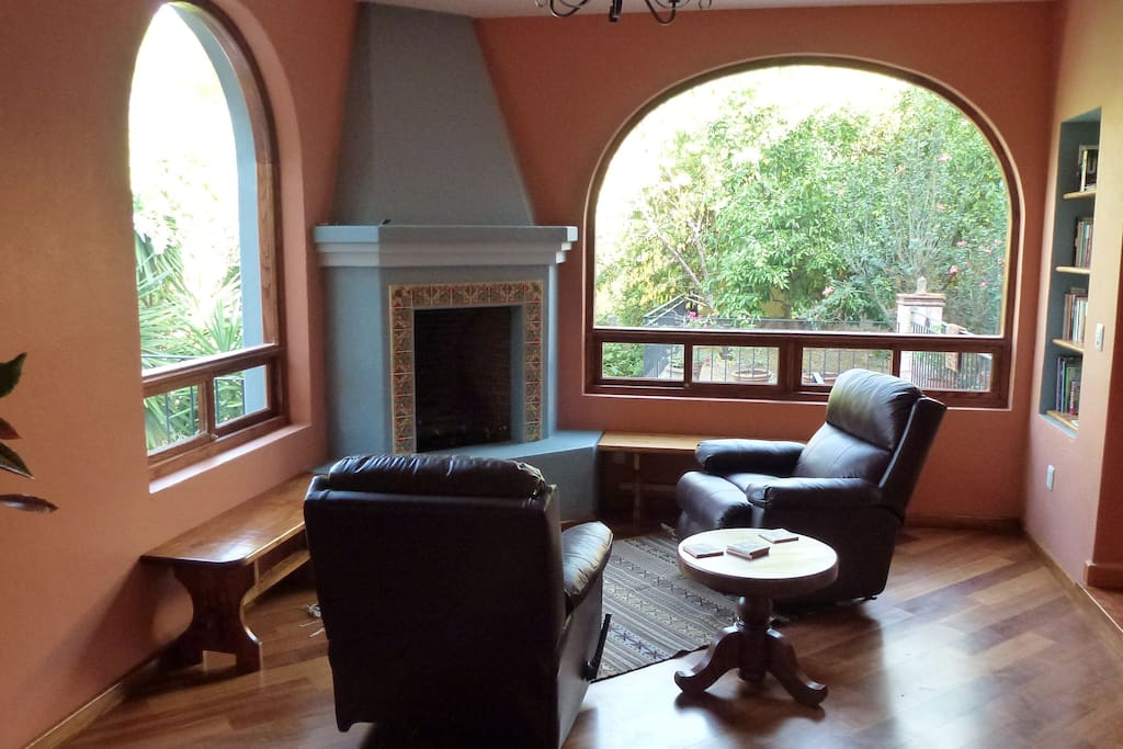 Den with gas fireplace and views of the garden