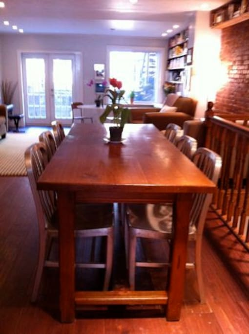Dining table, imported from France, slides out to seat 6-8 for dinner.