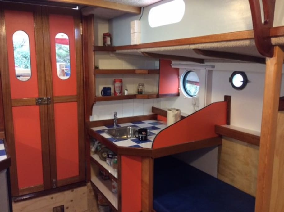 Port Galley with running water and kettle, fully equipped with crockery.