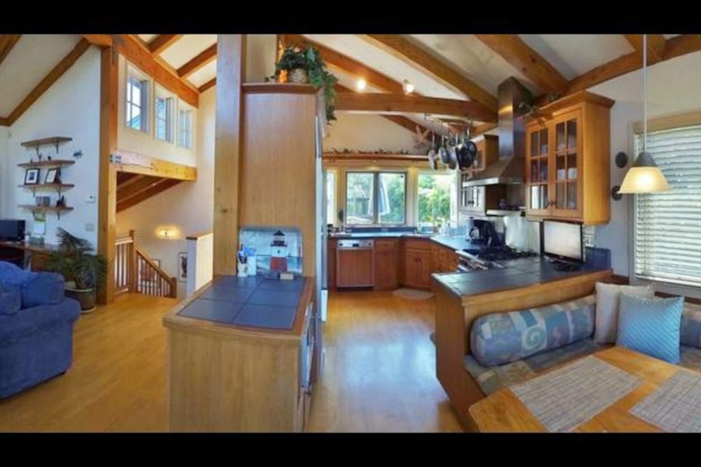 Upstairs LR with gas fireplace, dining area, and kitchen w/TV