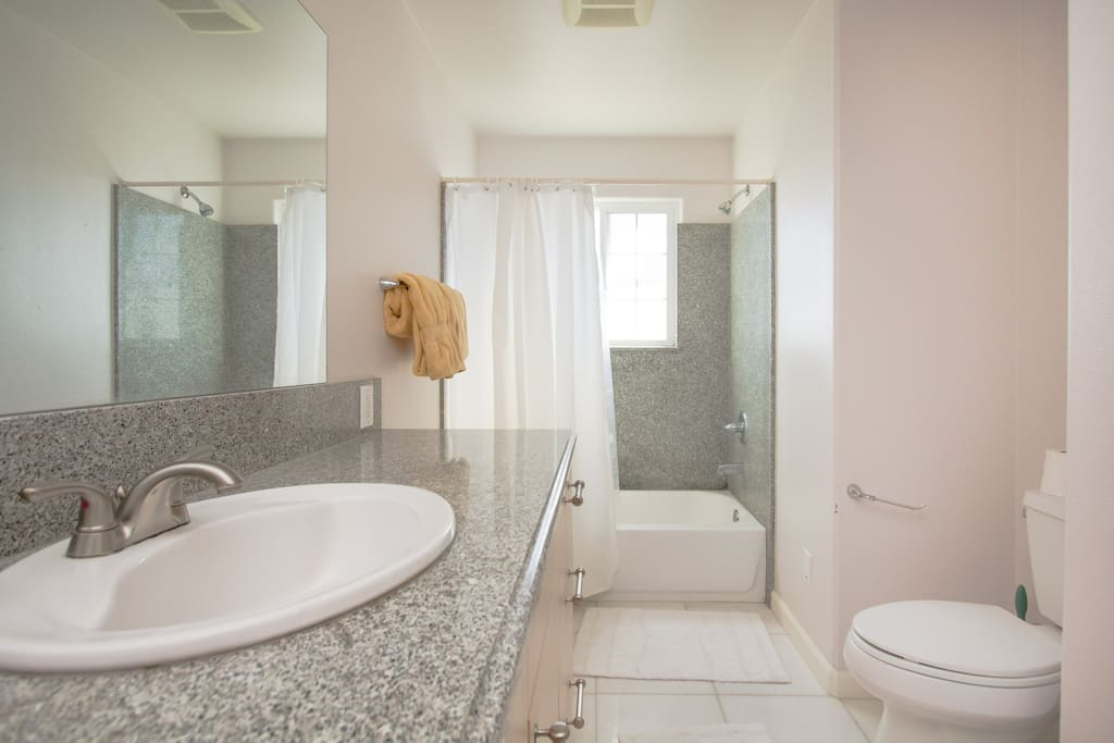 spacious bagth with shower/tub combo.