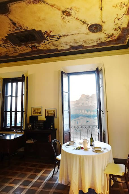 Dining table in the lounge/suite corner, overlooking the beautiful Siena old town, S. Francesco church and countryside