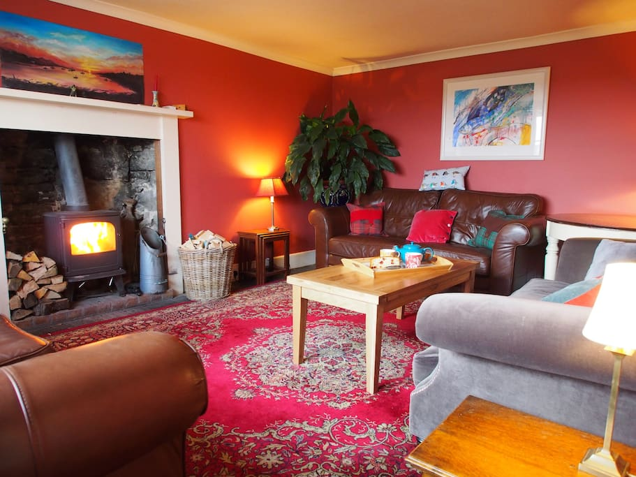 Sitting room with log burning stove.