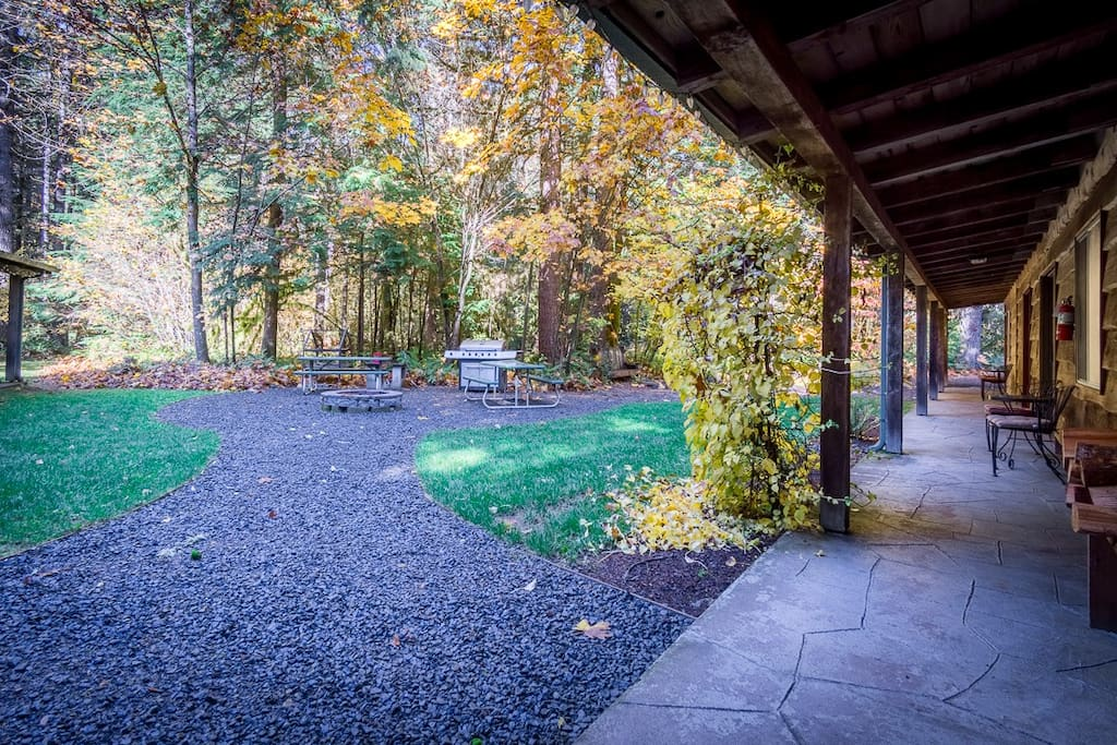 Private courtyard with fire pit and bbqs, view from kitchen door. We supply the firewood for your campfires! Lots of camp chairs available too!