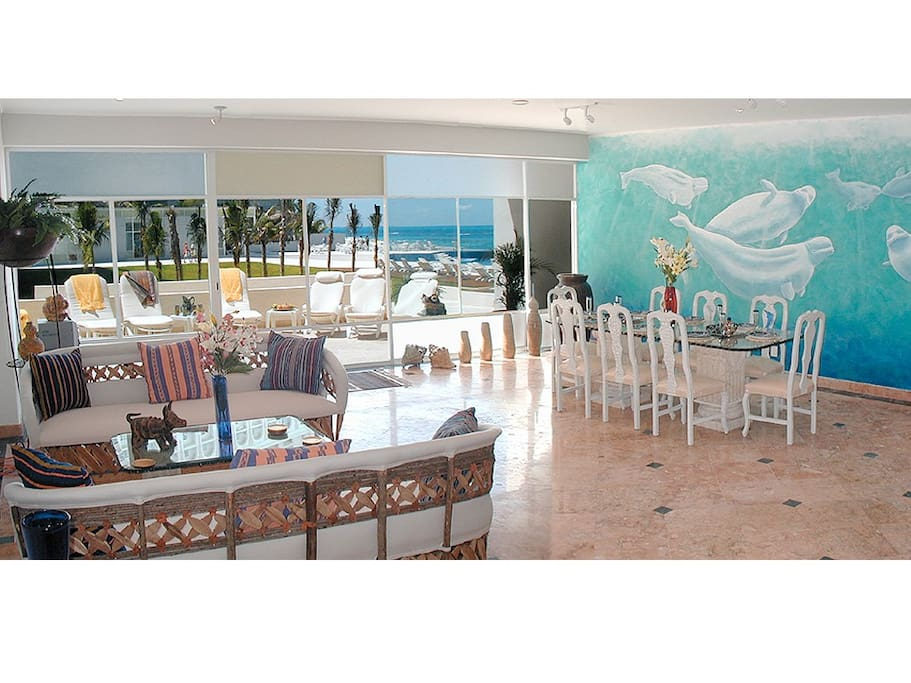 THE GROUND FLOOR LUXURY LIVING ROOM OPENS ONTO THE BEACH AND OCEAN.