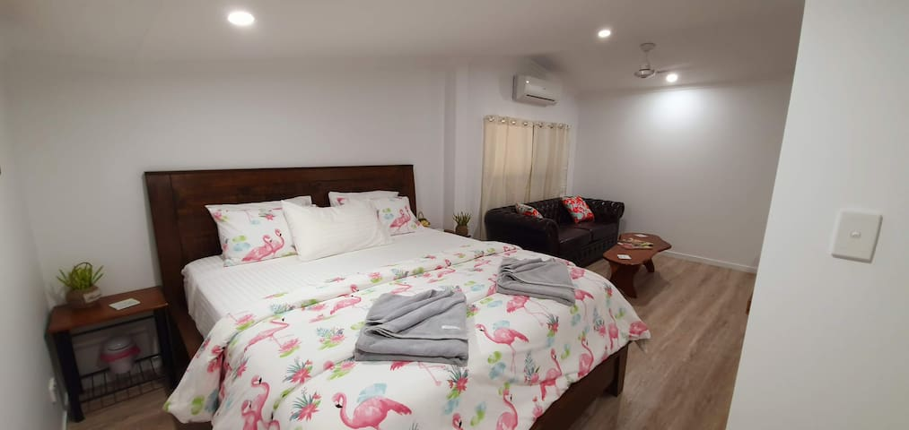 Large Super Comfortable King Bed with  Chesterfield Couch to kickback and read a book. Storage for clothes and a portable clothes rack, perfect for the ladies. Bedside tables to put your cuppa down whilst planning your day