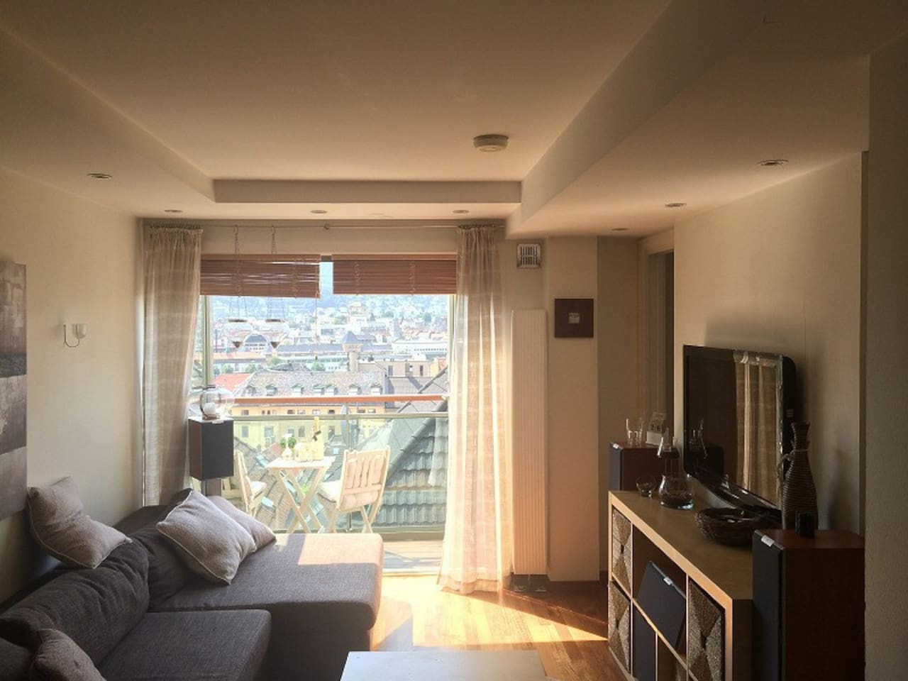 Livingroom with door to private balcony with great view over Bergen!