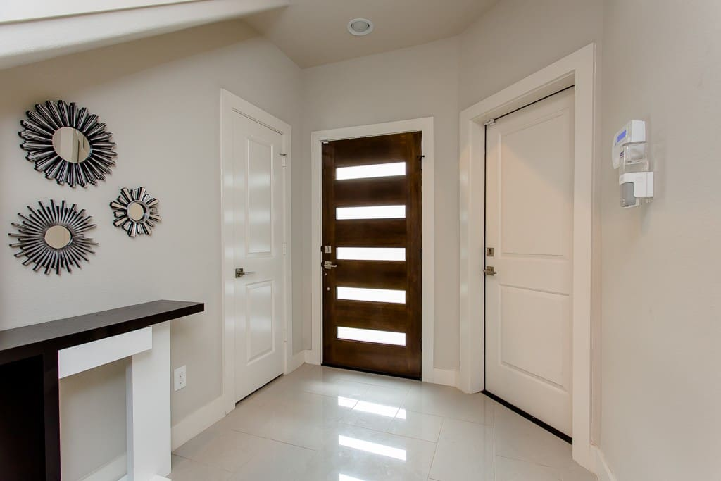 Foyer front entrance with garage door and closet on 1st floor