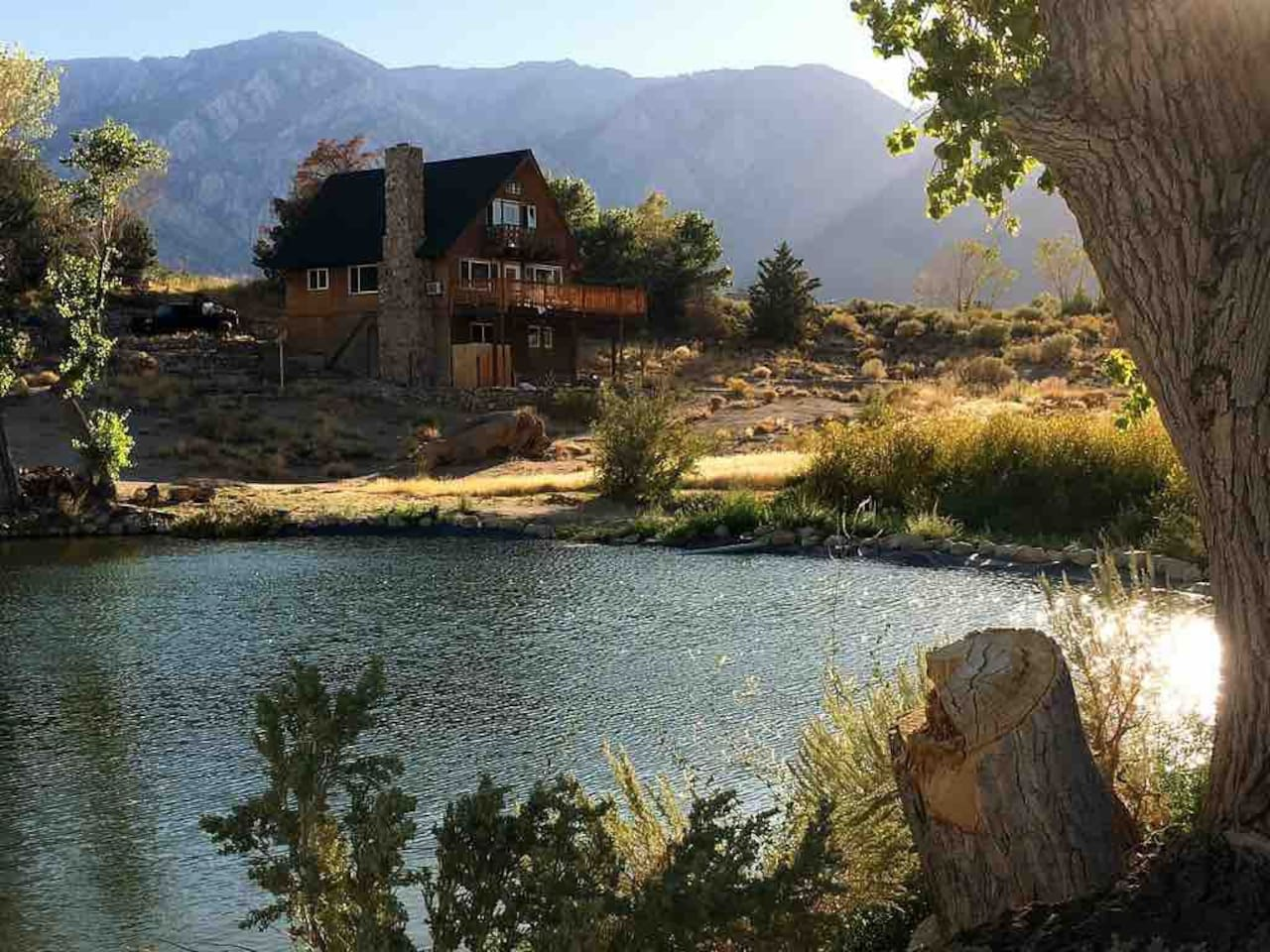 View of House, Lake, and Sierras behind.  House sits on rim, visible from Diaz lake on Hwy 395, below.