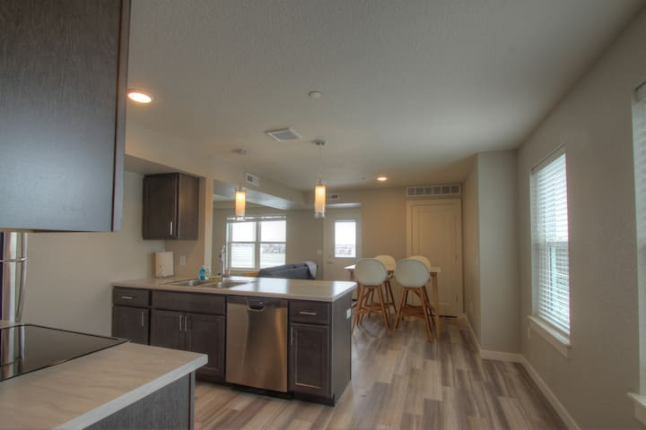 Bright, Modern 2 bedroom condo with large deck!