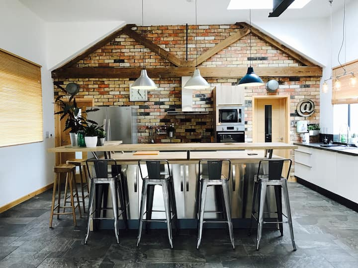 Large newly converted industrial/retro barn