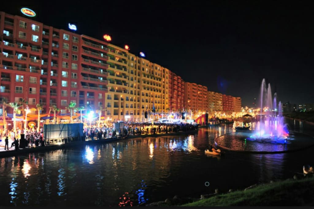 The artificial lake and dancing fountain along the shops and restaurants corridor