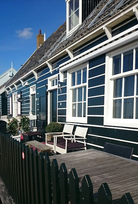 the front of the housewith terrace at the harboursite. Original  wooden Marker house
