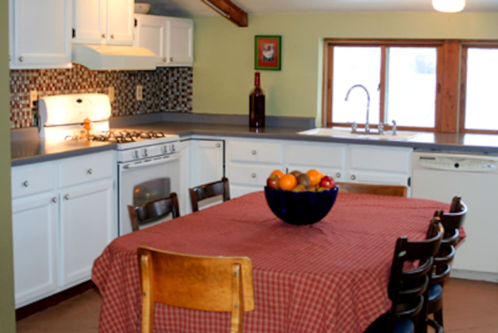 The kitchen and dining space. There are beautiful views of the River and garden. Often see Eagles flying overhead.