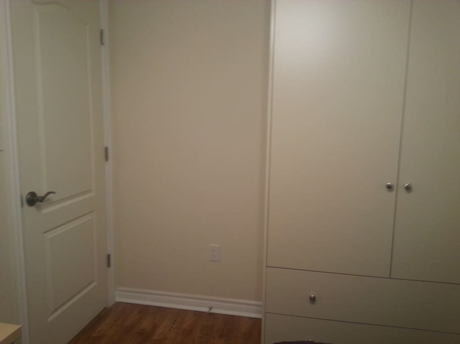 Custom build fill size wardrobe with two large storage draws, double sockets on each wall, sound proof insulation