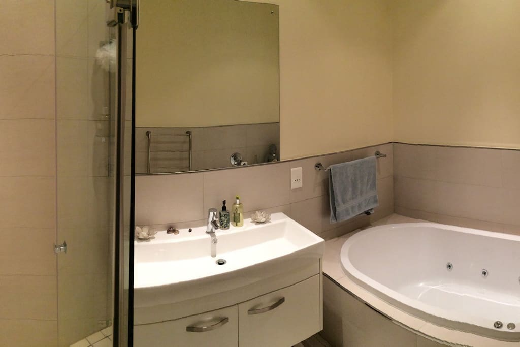 Luxurious en suite bathroom with shower and spa bath